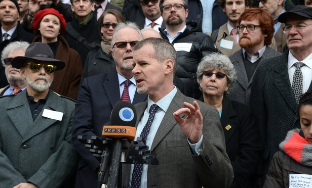 Christopher Dunn, associate legal director of the New York Civil Liberties Union, speaks at a press conference Wednesday on the steps of City Hall to announce a settlement with New York City for the arrests that occurred at the Republican National Convention in 2004. Behind him are Jonathan Moore and Rose Weber, two of the other principal plaintiffs lawyers in the case.