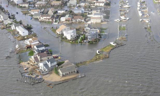 Long Island communities like this, shown in a Coast Guard photograph, were heavily impacted by Hurricane Sandy. More than a year after the disaster, the courts are facing hundreds of lawsuits.