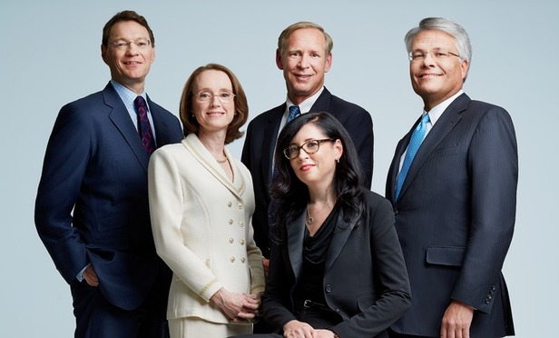 From left: Debevoise's Mark Goodman, Mary Beth Hogan, John Kiernan, Maura Kathleen Monaghan and Bruce Yannett.