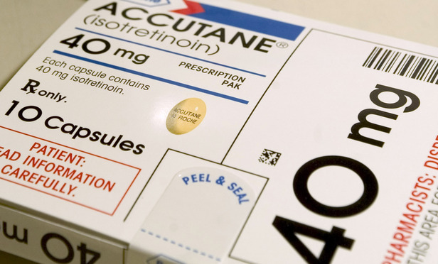 A Roche Holding AG's Accutane acne pill package is photographed in a pharmacy in Wilmette, Illinois on Friday, November 19, 2004. Concerns for the drug was expressed by FDA medical reviewer David Graham who told a U.S. Senate panel that the U.S. Food and Drug Administration should scrutinize the drug's side effects. Photographer: Tannen Maury/ Bloomberg News