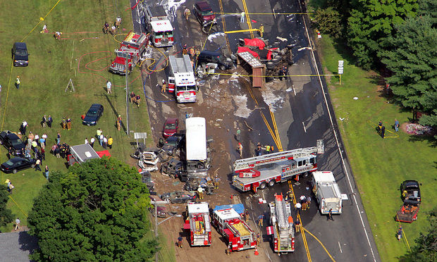 Emergency personnel and vehicles work an accident in Avon, Conn., that occurred Friday, July 29, 2005. At least five people were killed and several others injured in the multiple vehicle accident.