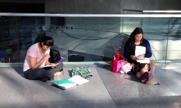 Aspiring attorneys review their notes before beginning the bar exam at the Jacob J. Javits Center on Tuesday.
