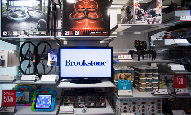 Drones and other remote controlled toys are displayed for sale in a Brookstone Inc. store.