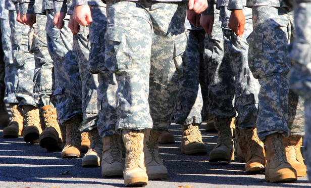 Transgender Military Ban Targeted by One of the World's Most Powerful Law Firms