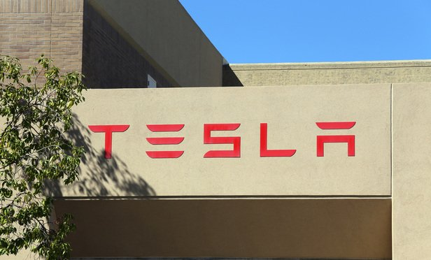 PALO ALTO, CA - MARCH 18: The Tesla Motors World Headquarters located in Palo Alto on March 18, 2014. Tesla Motors is an American company that designs, manufactures and sells electric cars.