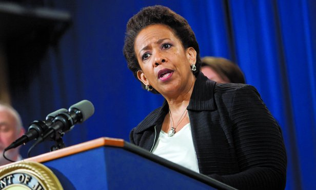 Attorney General Loretta Lynch announcing, during a press conference at the U.S. Department of Justice, that five major banks have agreed to plead guilty to felony charges of conspiring to manipulate the price of U.S. dollars and euros. May 20, 2015. Photo by Diego M. Radzinschi/THE NATIONAL LAW JOURNAL.