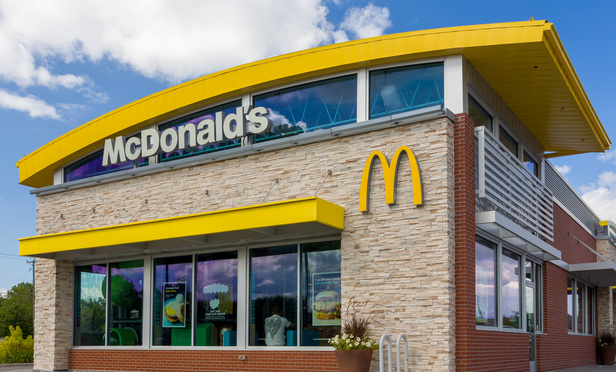 STILLWATER, MN/USA - August 10, 2015: Contemporary McDonald's exterior. The McDonald's Corporation is the world's largest chain of hamburger fast food restaurants.