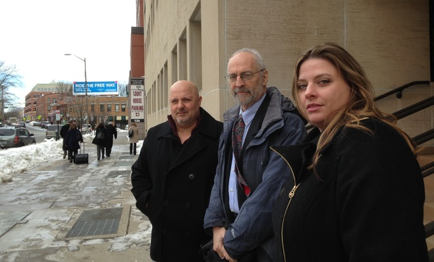 Howard Altschuler, center, with his clients Domenic and Cathy D'Attilos, in front of the New Haven courthouse Feb. 23.