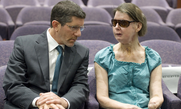 Charla Nash, right, talks with attorney Matthew D. Newman before for a hearing at the Legislative Office Building in Hartford, Conn., Friday, Aug. 10, 2012. Nash who was mauled in a 2009 chimpanzee attack is attending a hearing to determine whether she may sue the state for $150 million in claimed damages. (AP Photo/Jessica Hill)