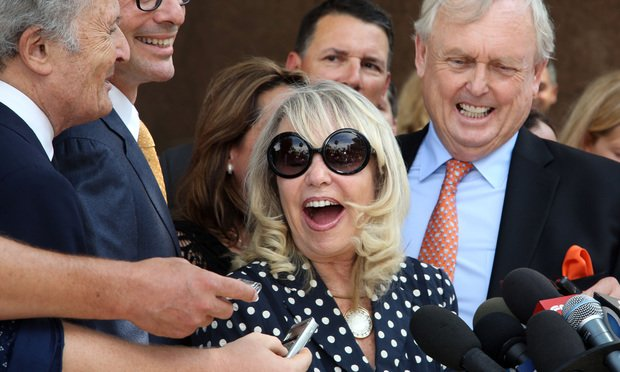 With her attorney Pierce O'Donnell, right, Shelly Sterling, center, talks to reporters after a judge ruled in her favor and against her estranged husband, Los Angeles Clippers owner Donald Sterling, in his attempt to block the $2 billion sale of the NBA basketball team, outside Los Angeles Superior Court Monday.