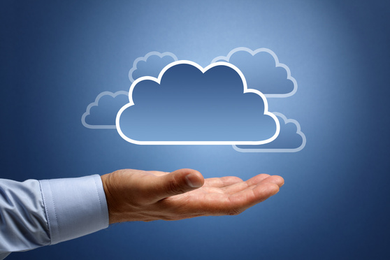 Cloud computing concept - busnessman hand connecting to the cloud