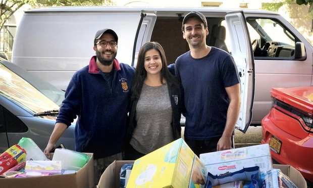 Pictured left to right: Columbia Law School students Patricio Martínez-Llompart '18, Eva Jiménez '18, and Jorge García '18 spearhead relief efforts for hurricane survivors back home in Puerto Rico.