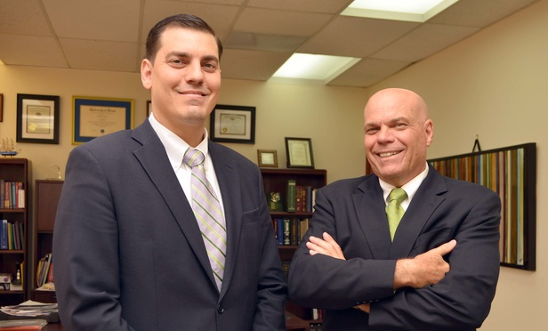 Attorneys Ricardo Corona Jr. and Ricardo Manuel Corona Sr.