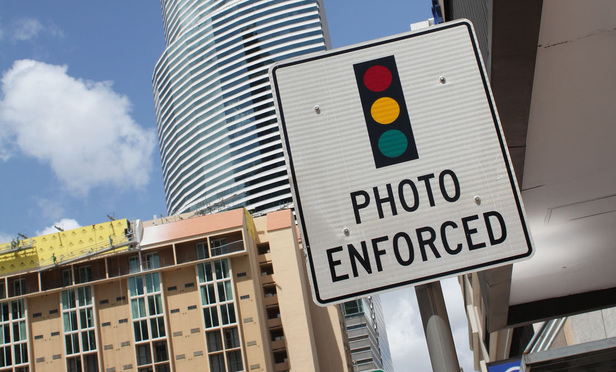 Photo Enforced Sign Warning Of Red Light Camera In Downtown Miami.