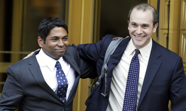 Rengan Rajaratnam, left, exits federal court with his attorney Daniel Gitner in New York on Tuesday, July 8, 2014.