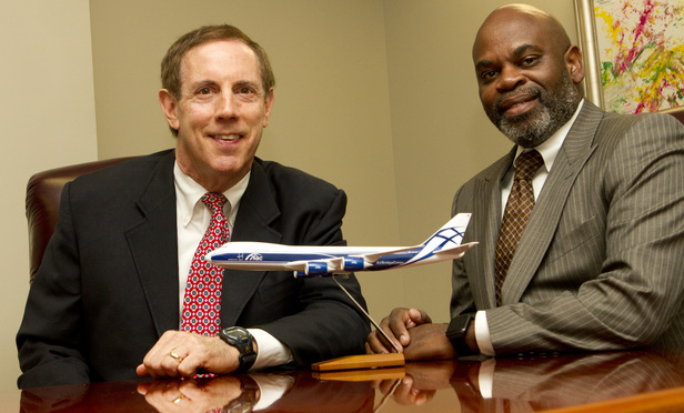 Bo Strauss, left, and Morris Little with a model of a 747-8 plane.