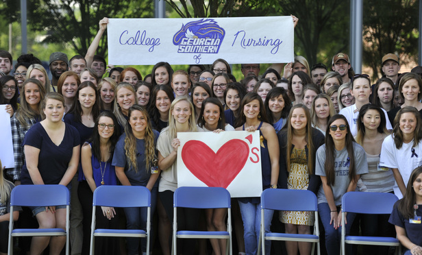 April 24, 2015 - Graniteville, South Carolina, U.S. - Georgia Regents College of Nursing students pose for a photo in front of five empty chairs, signifying the five Georgia Southern University nursing students who were killed in a car crash near Savannah, Ga., on Friday, April 24, 2015. In addition to sending a photo, the students plan to collect funds to send to Georgia Southern's student government association, which will decide how it is allocated.