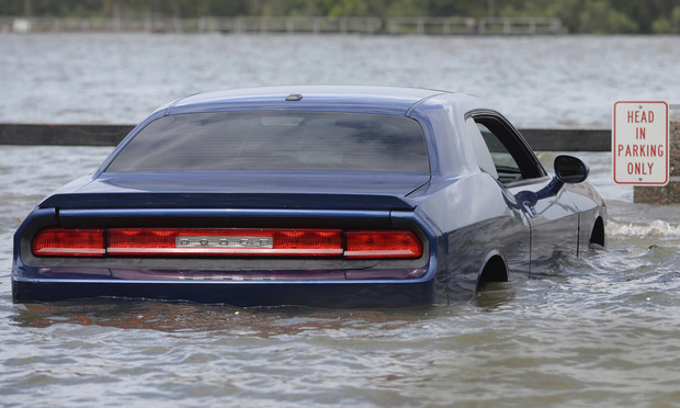 A car parked on River Street in Savannah, Georgia, is surrounded by floodwater from the Savannah River on Monday after Hurricane Irma moved through.