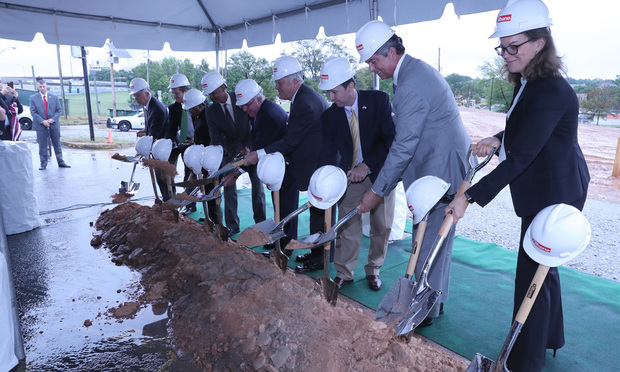 Turning the first shovels on Georgia's new Judicial Complex Thursday were (from left) former Georgia Supreme Court Justice Hugh Thompson, Justice Nels Peterson, Justice Robert Benham, Justice Harold Melton, Chief Justice Harris Hines, Gov. Nathan Deal, Justice Keith Blackwell, Justice Michael Boggs and Justice Britt Grant.