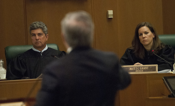 L-R Newly appointed Georgia Supreme Court Justices Michael Boggs and Britt Grant listen to Paul Weathington give arguments at the Supreme Court of Georgia on Monday January 9th 2017.