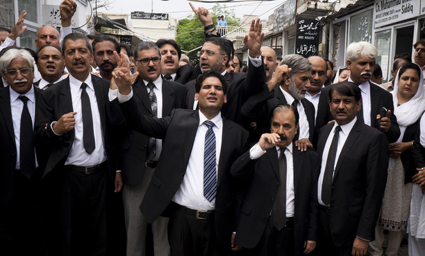 Pakistani lawyers chant slogans to condemn Monday's suicide bombing that took place in the southwestern city of Quetta that killed and wounded scores of people, mostly lawyers., in Islamabad, Pakistan, on Tuesday, Aug. 9, 2016.