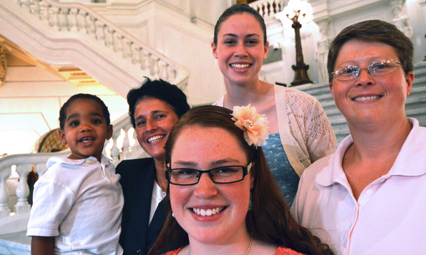 The Whitewoods—from left, Landon, Susan, Abbey, Katie and Deb—pose together after a news conference July 9, 2013, in Harrisburg to announce that they are the lead plaintiffs in Whitewood v. Wolf . Pennsylvania's ban on same-sex marriage was overturned Tuesday.