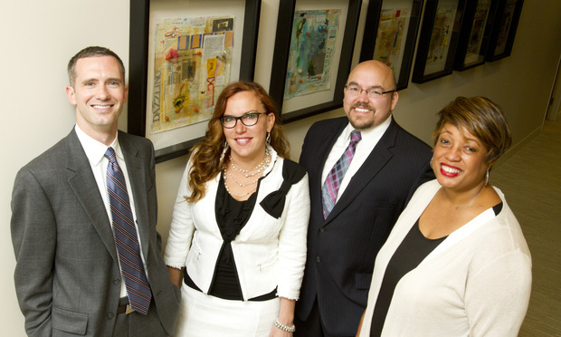Baker Hostetler's new IP litigation team, from left: Jason Grier, Katrina Quicker, Michael Riesen and Valerie Dotson.