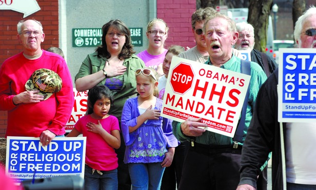 Protesters in front of the federal courthouse in Williamsport, Penn. during a rally against the Obamacare HHS contraception mandate on Friday March 23, 2012.