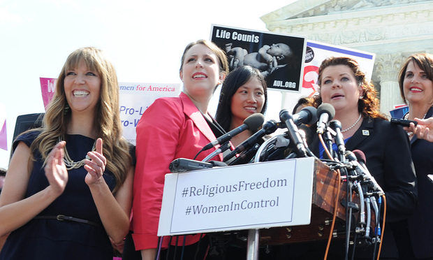 Demonstrators outside the U.S. Supreme Court, on the day the Court issued its decision in the Burwell v. Hobby Lobby case
