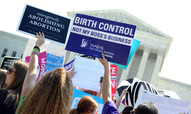 Demonstrators outside the U.S. Supreme Court, on the day the Court issued its decision in the 'Burwell v. Hobby Lobby' case.