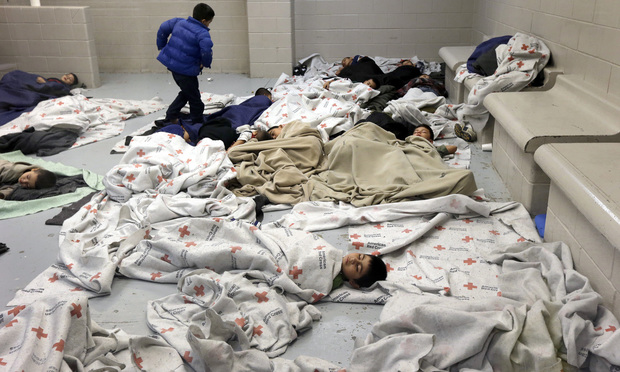 Detainees sleep in a holding cell at a U.S. Customs and Border Protection processing facility in Brownsville,Texas.