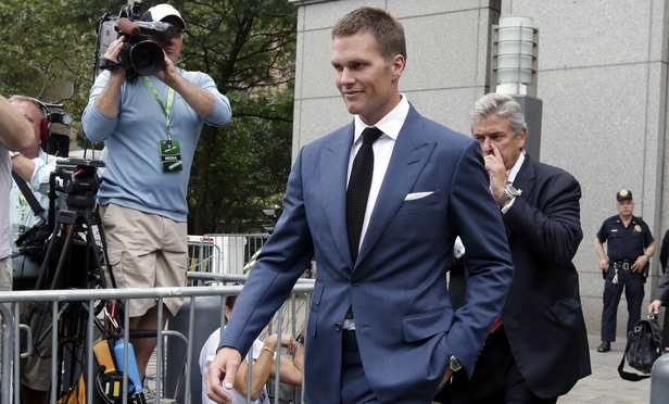 New England Patriots quarterback Tom Brady leaves federal court in New York.