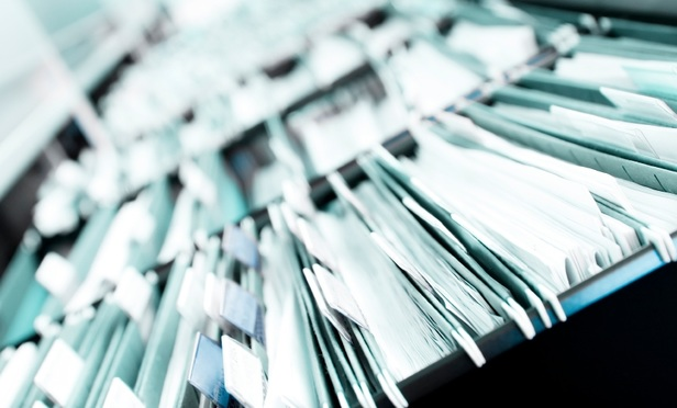Scanning the Records Room: The Final Frontier in Going Paperless