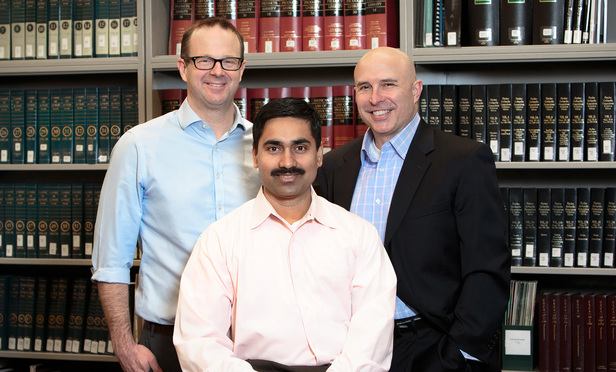 (l-r) Jeffrey Marple, Innovation Director Corporate Legal, Kiran Mallavarapu, Senior Vice President and Manager, Legal Strategic Services, seated, and Robert Taylor, Vice President, Senior Corporate Counsel & Manager, with Liberty Mutual Insurance. March 31, 2017.