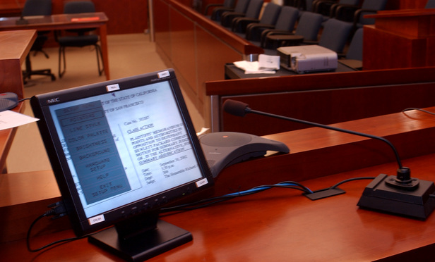 Judge Richard Kramer's courtroom is one of the first to use a new high tech display device that combines many multi-media functions into one.