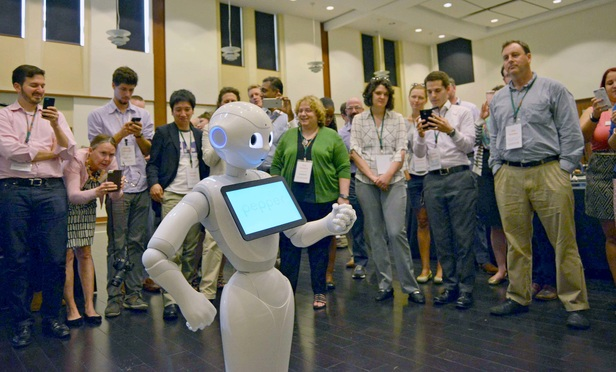 Artificial Intelligence robot Pepper dances for the audience during the We Robot 2016 conference held at the UM Law School.