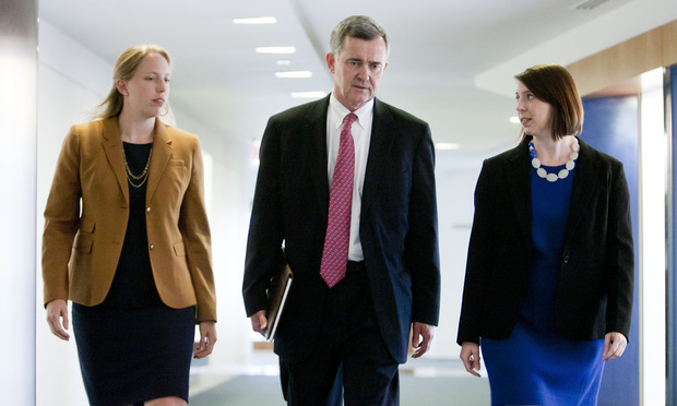 (l-r) Catherine Creely, Mark MacDougall, and Karen Williams, of Akin Gump Strauss Hauer and Feld. July 9, 2014. Photo by Diego M. Radzinschi/THE NATIONAL LAW JOURNAL.