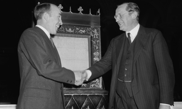 Lord Lothian (right), British ambassador to the United States, transfers the Lincoln Magna Carta to Librarian of Congress Archibald MacLeish (left) for safekeeping during World War II, 1939.