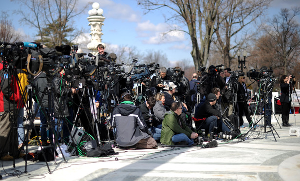 Media gathered outside the U.S. Supreme Court on the day of arguments in the case challenging California's Prop 8 legislation