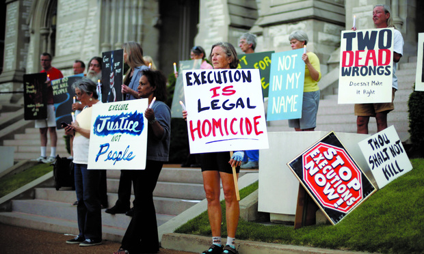 VIGIL: Capital punishment foes protested outside a St. Louis church on May 20, as the planned execution of Missouri death row inmate Russell Bucklew neared. The Supreme Court intervened.