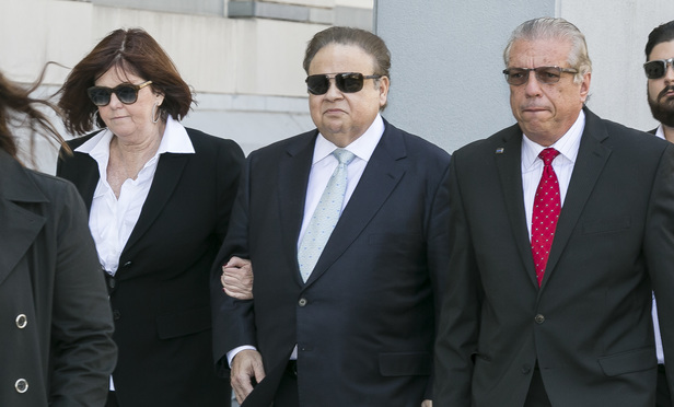 Dr. Salomon Melgen, center, indicted on bribery charges along with N.J. U.S. Sen. Robert Menendez, outside the federal courthouse in Newark, New Jersey.