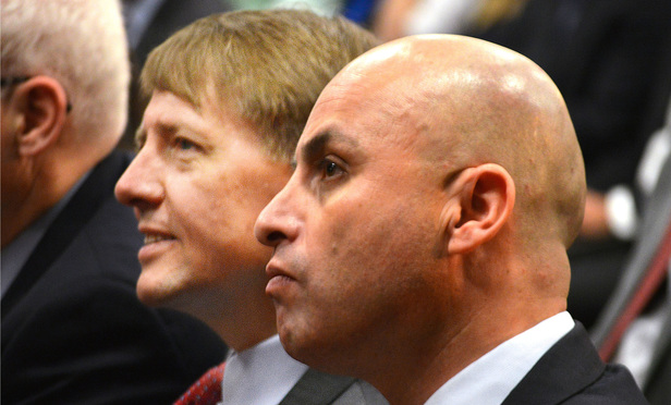 Consumer Financial Protection Bureau director Richard Cordray, left, and New Mexico Attorney General Hector Balderas, right, sit together at the Albuquerque Convention Center in Albuquerque, N.M., on Thursday, May 5, 2016, before the start of a bureau meeting.