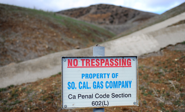 A sign declares the boundary line of the Southern California Gas Co. gas fields where a gas well has been leaking methane daily near the community Porter Ranch, California.