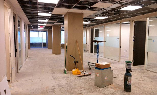 Fluet Huber + Hoang's Chisel co-working space in Tysons, Virginia, is still under construction. It will open to lawyers who rent desks there in August.