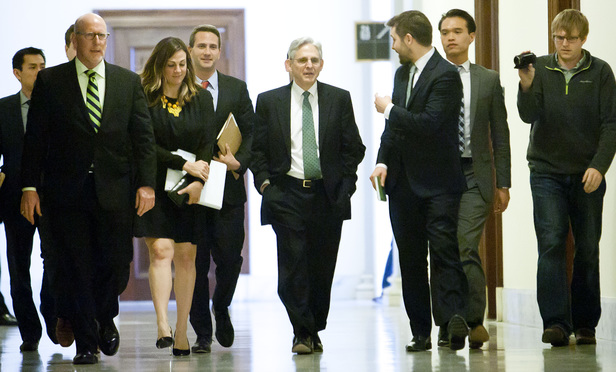 Supreme Court nominee Merrick Garland, chief judge of the U.S. Court of Appeals for the District of Columbia Circuit, walks to Sen. Patrick Leahy (D-VT)'s office at the Russell Senate Office Building on March 17, 2016.
