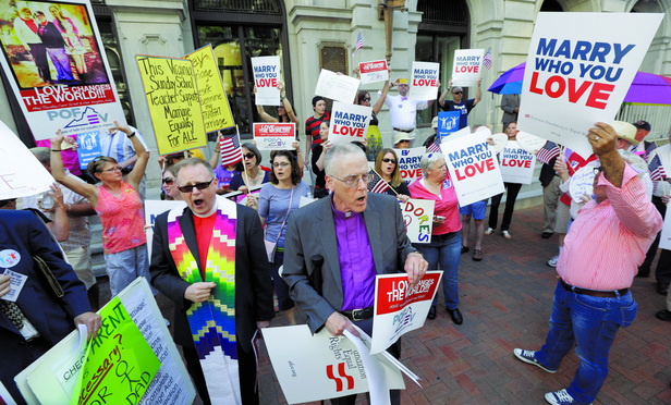 Supporters of gay marriage demonstrate outside the Federal Appeals Court in Richmond, Va., Tuesday, May 13, 2014.