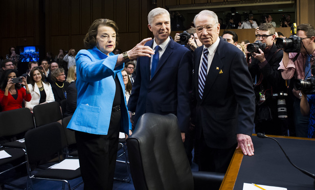 Senators Dianne Feinstein (D-CA), left, and Chuck Grassley (R-IA), right, with judge Neil Gorsuch, center, before the start of his confirmation hearing before the Senate Judiciary Committee to replace the late Justice Antonin Scalia at the U.S. Supreme Court. March 20, 2017.