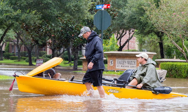 Residents of Sienna Plantation Houston suburb in ride a canoe in high waters, Missouri City, Texas - August 29, 2017.
