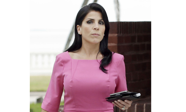 Jill Kelley leaves her home Tuesday, Nov 13, 2012 in Tampa, Fla.