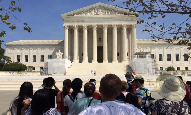 Visitors outside the U.S. Supreme Court on August 29, 2015.
